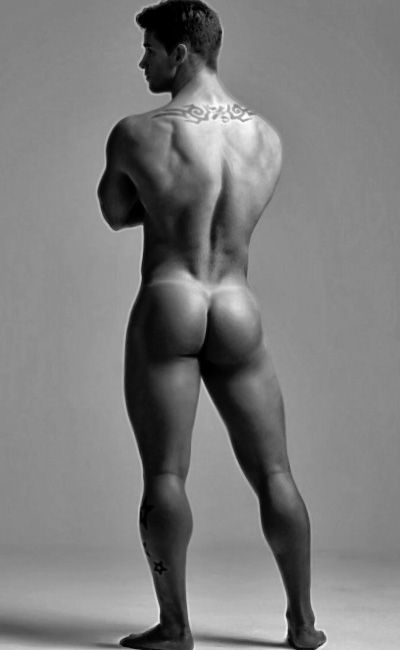 Nude black man in a thong